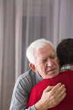Father saying last goodbye. Father saying last good bye to son Stock Photo