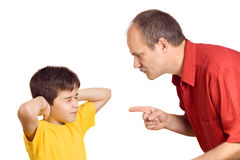 Father scolding his son. With pointed finger stock images