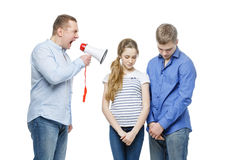 Father screaming at teenage children Stock Image