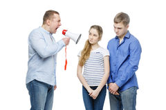 Father screaming at teenage children Royalty Free Stock Photos