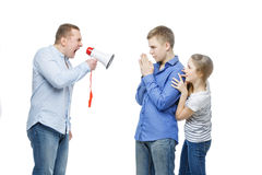 Father screaming at teenage children Stock Photography