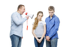 Father screaming at teenage children Stock Images