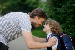 The father sees his son at school first-grader Royalty Free Stock Photo