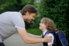 The father sees off in school of the son-first-grader. Stock Images