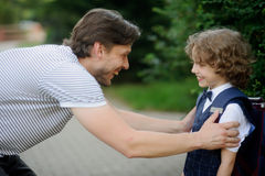 The father sees off the son-schoolboy in school. Royalty Free Stock Photos