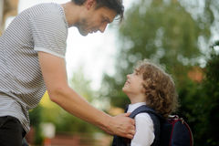 The father sends in school of the son-first-grader. Royalty Free Stock Photography