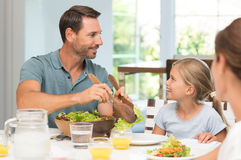 Father serving food Stock Photos