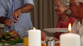 Father serving roast chicken at the dinner table stock footage
