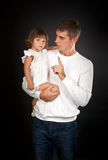 Father shaking his finger at a small daughter Stock Photos
