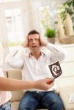 Father in shock of having baby Royalty Free Stock Image