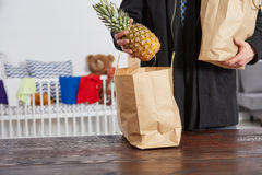 Father with shopping bags. Close up of father with shopping bags, cot in background Stock Images