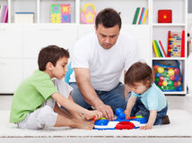 Father showing his sons a new toy Stock Photos
