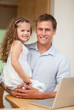 Father showing laptop to his daughter Stock Photography
