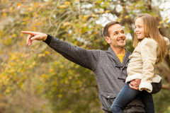 Father showing something to his smiling daughter Stock Image