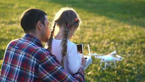 Father shows his daughter how to control drone stock video