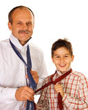 Father shows the tie binding. Help or success concept: father shows his son the tie binding royalty free stock photos