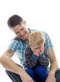 Father and shy son Stock Photography