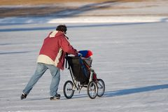 Father Skating with Baby Stock Image