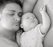 Father sleep with baby. Royalty Free Stock Image
