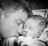 Father sleeping with baby son Stock Photos