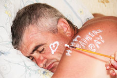 Father Sleeping. Child Drawing Heart. Stock Photos