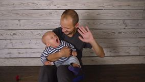 Father with a small baby stock footage