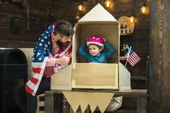 Father and small boy in paper rocket with American flag. Family and childhood. Patriotism and freedom. Travel and royalty free stock photos