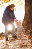 Father and small daughter walking at riverbank Royalty Free Stock Photography