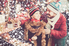 Father and small kid are looking for gifts Stock Image