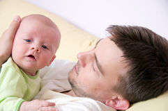 Father with smiling newborn. Smiling baby in father's embrace Royalty Free Stock Images