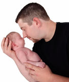 Father snuggling his newborn. isolated Royalty Free Stock Photo
