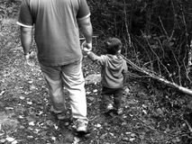Father and Son. Walking in the woods Stock Photos