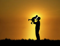 Father and Son 1. Silhouette of father and son at sunset stock illustration