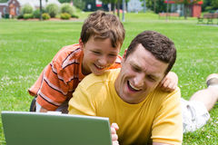 Father and son. With a computer outside Stock Photo