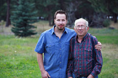 Father and son. Posing, rural setting Royalty Free Stock Images