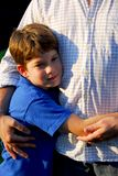 Father and son. Little boy hugging his father Stock Images