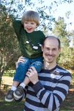 Father And Son. Proud father holds his two year old son on his shoulder Royalty Free Stock Photos