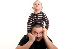 Father and son. Man holding a child on his shoulders Royalty Free Stock Images