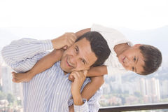 Father and son. Portrait of family, father and son enjoying at home Royalty Free Stock Photography