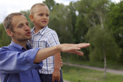 Father and Son. Father showing an telling something to his son Stock Image
