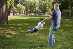 Father and son. Spinnig at the park Royalty Free Stock Images