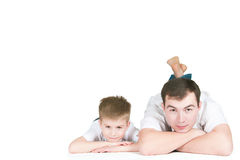 The father and son. The father with the son lie on a white background Royalty Free Stock Photos