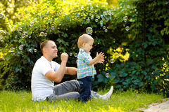 Father and son. Playing with soap bubbles Stock Photos