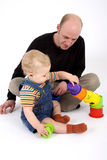 Father & Son. A baby with dad and some toys royalty free stock photo