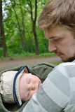 Father and son. Father holds sleeping son in his arms Stock Image
