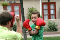 Father and son. Boxing in the park Royalty Free Stock Photo