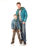 Father and Son. Happy Father and Son on the White Background.They Dressed in Similar Warm Jackets Stock Photography