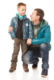 Father and Son. Happy Father and Son on the White Background.They Dressed in Similar Warm Jackets stock photos