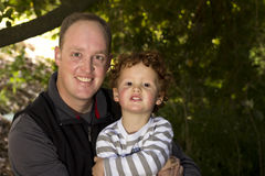 Father and son in outdoor setting Royalty Free Stock Photography