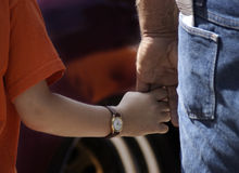 Father and Son. A young boy holding the man of an adult male. Father and son Stock Photos